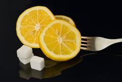 Citroen en suiker stock afbeelding
