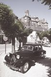 Citroen traction avant parked near a medieval castle in Estaing, France stock image