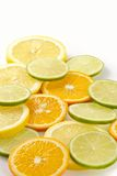Citron allsorts-lime, lemon, tangerine. Cut on slices and laid out for preparation of cocktails and soft drinks Stock Photos
