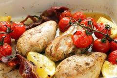 Citron et tomates cuits au four de poulet Images stock