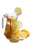 Citron i exponeringsglas på vit en royaltyfria bilder