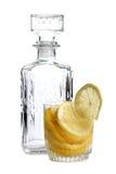 Citron i exponeringsglas på vit sex royaltyfria bilder