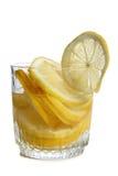 Citron i exponeringsglas på vit två arkivfoto