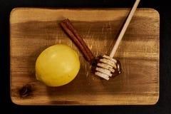 Citron, kanel och honung Arkivbild