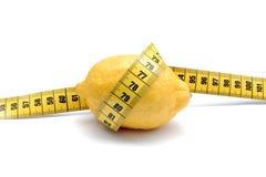 Citron med att mäta för längd Royaltyfri Fotografi