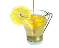 Citron- och honungdrink arkivfoto