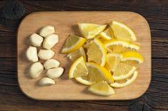Citron och vitlök arkivbild