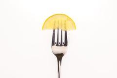 Citron sur une fourchette Images stock