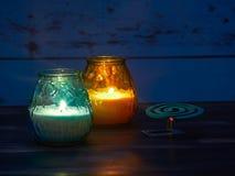Citronella κεριά και σπείρα κουνουπιών Στοκ Εικόνες