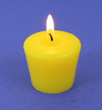 A citronella candle that has been lit Stock Photos