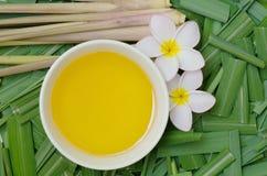 Citronella oil for spa. Citronella Grass and oil on citronella grass leave background Royalty Free Stock Photo