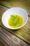Citronella Plant Mosquito Repellant. A citronella plant leaf resting in oil to make homemade mosquito repellant stock photos
