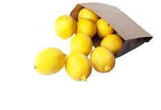 Citroner i den paper packen Fotografering för Bildbyråer