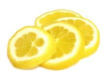 Citronskivor som isoleras på en vit bakgrund Royaltyfri Bild