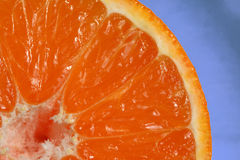 Citrus. Macro image of a  juicy Clementine, could also be an orange or a tangerine Stock Photo