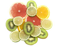 Citrus. Slices of a ripe citrus, it is isolated on white Royalty Free Stock Photos