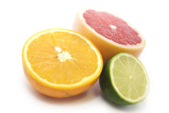 Citrus. Slices of a ripe citrus, it is isolated on white Stock Image