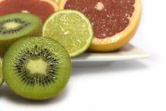 Citrus. Slices of a citrus, halves of an orange, grapefruit and a kiwi Stock Photography