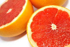 Citrus. Halves of a citrus is isolated on white, grapefruit halves Stock Images