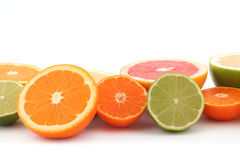 Citrus. Half of Oranges, limes, grapefruits, lemon and tangerine. Citrus fruits on white background close up royalty free stock photography