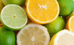 Citrus. Fresh lemons, limes, oranges background stock photo