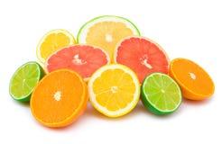 Citrus abundance. Mandarine (orange), lemon, grapefruit and lime halves together isolated on white Royalty Free Stock Photo