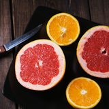 Citrus background, grapefruit and orange slices royalty free stock images