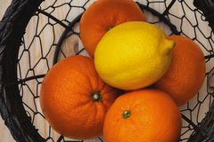 Fruits in a basket on a kitchen table top view royalty free stock photo