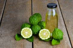 Citrus bergamia and Bergamot essential oil. Fresh bergamot fruit with Citrus bergamia and Bergamot essential oil on wooden table background stock image