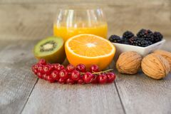 Citrus,berries and nuts. Composition of citrus fruits,berries and nuts on wooden background Royalty Free Stock Image