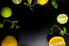 Citrus on black background. top view. no photoshop used. copy sp. Lime orange and lemon on black background. top view. no photoshop used. copy space for text royalty free stock photography