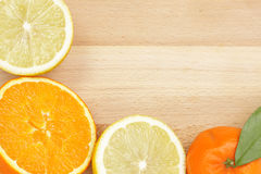 Citrus border on wooden table Stock Photography