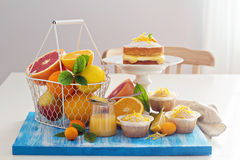Citrus candy bar with fruits and cakes Royalty Free Stock Images