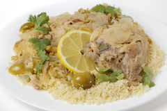 Citrus chicken with olives and couscous Royalty Free Stock Images