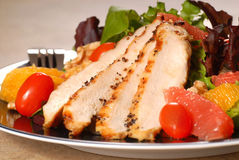 Citrus chicken salad. Fresh chicken salad with grapefruit, orange and tomatoes Royalty Free Stock Image
