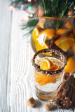 Citrus cocktail in the decorated glass on the white wooden table vertical Stock Image