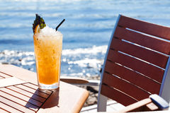 Citrus cocktail with ice, lemon and basil Royalty Free Stock Photos