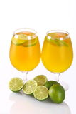 Citrus cocktail with lime. Lime with citrus cocktail glasses on a white background Stock Image