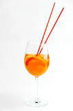 Citrus cocktail on white. Glass of cocktail with orange and ice with a straw on white Royalty Free Stock Photography
