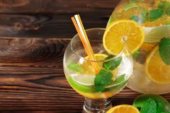 Citrus Cocktail With Oranges, Limes And Mint On A Wooden Background. Close-up Glass Of Alcohol. Alcoholic Party Drinks. Royalty Free Stock Photos