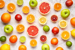 Citrus colorful fruits background mix flat lay, summer healthy vegetarian vitamin food