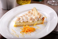 Citrus cream cheesecake  piece with orange zest close-up Stock Images
