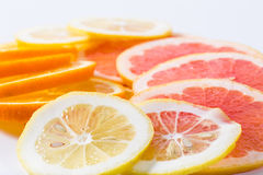The citrus cut by circles lies on a table Royalty Free Stock Photography