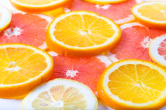 The citrus cut by circles lies on a table Royalty Free Stock Images