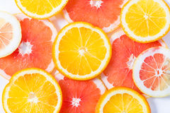 The citrus cut by circles lies on a table Stock Images