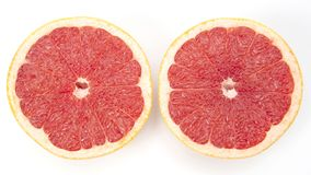 Citrus cut fruit grapefruit on white background. Vitamin healthy food stock images