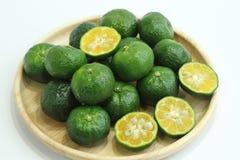 Citrus depressa (Taiwan tangerine, flat lemon, hirami lemon). Sour fruit juice is delicious Shikuwasa cooking Royalty Free Stock Photography