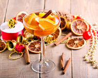 Citrus drink with spices,. Vintage wooden background Royalty Free Stock Photography
