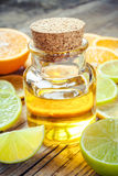Citrus essential oil and slice of orange, lemon and lime fruits Royalty Free Stock Image