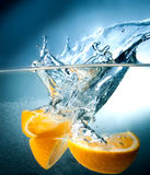 Citrus fall into the water Royalty Free Stock Images